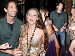 Adrien Brody and model girlfriend show off their tummy-jiggling moves with Turkish dancers at Istanbul night club