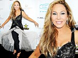 One outfit, two events: Adrienne Maloof gets her money's worth from unusual frock as she hits two parties in layered tulle number