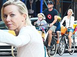 Back to wheel life! Naomi Watts embraces family time as she pedals around the city with Liev Schreiber and their boys