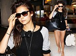 Here's to traveling light! Nina Dobrev jets into LAX in barely-there shorts after a Tokyo vacation with friends