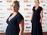 Baby bump in blue! Kate Winslet shows off her pregnancy curves at the Toronto International Film Festival debut of Labor Day