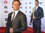 The 33-year-old British actor whizzed around Hollywood on the intimidating beast before ditching the biker guy look and slipping into a suave suit for his turn on the red carpet.