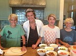 Harry Styles poses with Cindy Crawford's son Presley (left) and two pals on Sunday