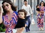 A flattering outfit for a Mother of three! Ali Landry wears striking dress for kids concert with her husband and son