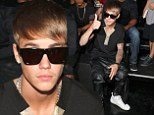 The Bieber is back! Justin returns to his roots with youthful haircut as he takes front row seat at Y-3 Fashion Week show