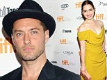 Daddy dearest: Emilia Clarke is radiant in yellow as she reunites with screen dad Jude Law at TIFF premiere of Don Hemingway