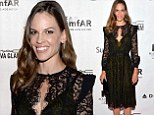 Dainty in lace! Hilary Swank keeps things classy in a black and olive green dress as she steps out at Toronto gala