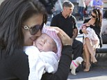 Stylish mama! Alec Baldwin's wife Hilaria sports FOUR INCH heels as she takes her two-week-old baby Carmen for a walk in New York City