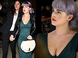 Shine bright like an emerald! Kelly Osbourne highlights her hourglass curves in green dress as she's joined by fiancé Matthew for Zac Posen NYFW show