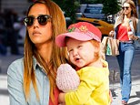 On the go Mom! Jessica Alba keeps her bouncing girl Haven close as she stylishly runs errands in denim jeans and orange top