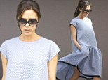 We can barely see you under there! Pint-sized Victoria Beckham is swamped as she steps out in a billowy tent dress from her new collection