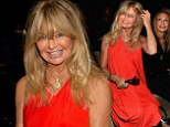 You can't miss her! Goldie Hawn makes sure to brighten everyone's day at the Donna Karan runway show