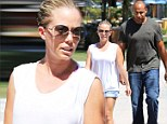 Kendra Wilkinson stays cool in billowy white top and shorts to grab lunch with husband Hank Basket