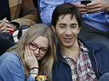 Love match: Amanda Seyfried and Justin Long cuddled up on Monday while watching the men's final of the US Open tennis tournament in Flushing Meadows, New York