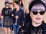 Kelly Osbourne gives her chic outfit a twist with a retro updo and headband as she continues taking New York by storm