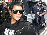 RIHANNA DONS A PAIR OF LEATHER WADERS AS SHE