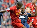 Crunch point: Johnson injured his ankle in this collision with United defender Patrice Evra