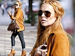 Actress Lindsay Lohan channels the 1960s in a flower headband and suede jacket while shopping in NYC