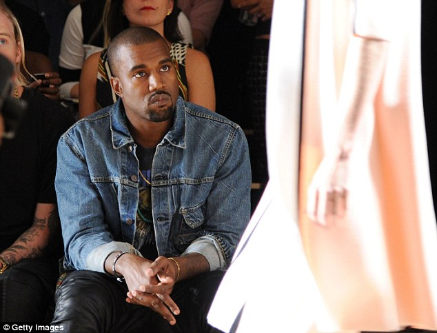 See something you like? The Yeezus rapper stared intently at the designs as the models sashayed up the runway