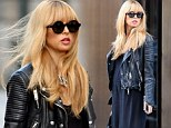 She's starting to show! Pregnant Rachel Zoe reveals a hint of baby bump as she steps out in a long black maxi dress