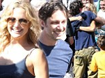 That's a wrap: Kate Hudson and Zach Braff posed for a group photo with the cast and crew of Wish You Were Here on Friday after wrapping filming in Pasadena, California