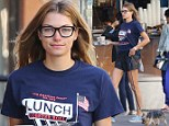 Two coffees, one pup: Australian model Jessica Hart dresses down for Monday morning java run and dog walk in New York City