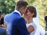 Just married! Professor Green and Millie Mackintosh embrace after their wedding ceremony on Tuesday