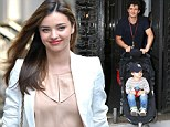 That's a little more ladylike! Miranda Kerr covers up from head-to-toe to go to the tennis with her parents after overexposing herself on the red carpet