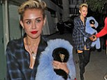 Miley Cyrus leaving a photo studio in London, carrying an oversized blue flurry jacket