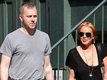 New man? According to reports, Lindsay Lohan is referring to somebody as her boyfriend and she certainly looked happy to be strolling with this man in Manhattan on Tuesday
