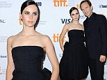 Playing it safe! Felicity Jones is elegant in a voluminous black strapless puffball gown as she joins co-star Ralph Fiennes at the TIFF premiere of The Invisible Woman