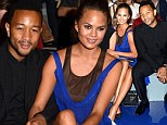 Engaged couple John Legend and Chrissy Teigen cuddle at the Vera Wang NYFW runway show