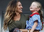 Funny girl: Sarah Jessica Parker's daughter Marion kept her laughing and smiling during the US Open final in New York on Sunday