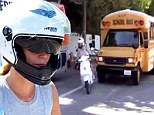 Lucky escape: Gwyneth Paltrow pulled out in front of a school bus while driving a scooter in LA with daughter Apple on the back on Wednesday