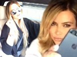 Sisterly love! Blonde bombshell Kim Kardashian helps take Khloe's mind off her marriage troubles during a Drake singalong with the family