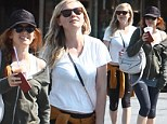 So THAT'S how they do it! Friends Kirsten Dunst and Isla Fisher show off their slim figures as they emerge from a joint gym session