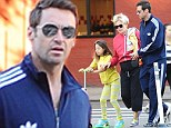 Back to Daddy duty: Hugh Jackman joins wife and daughter on the school run just days after premiering Prisoners at TIFF