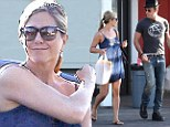 Nesting in! Jennifer Aniston enjoys a lazy Sunday grocery run with Justin Theroux... as they settle into their $21m mansion