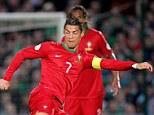 Shwoman: Cristiano Ronaldo back-heels the ball through the legs of Steven Davis on Friday night