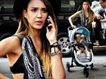Yummy mummy! Trendy mother-of-two Jessica Alba flashes her bra on day out with daughter Haven