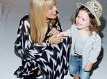 Earth mother! Rachel Zoe covers up her pregnancy figure in a billowing boho kaftan as she's supported by her son Skyler at her New York Fashion Week show