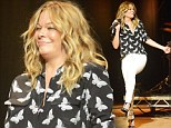Kicking up her heels! A curvier LeAnn Rimes is healthy and full of energy as she takes to the stage to perform in a pair of tight white jeans and butterfly blouse