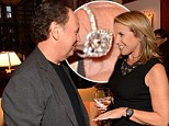 You're blinding me! Katie Couric continues to show off her diamond sparkler as she mingles at Billy Crystal's book party