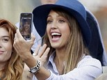Time out! Jessica Alba took a break from watching Nadal smash Djokovic in New York's US Open tennis final on Monday to take a beautifully constructed 'selfie' on her smartphone