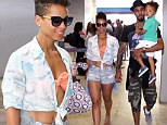I've already got my bikini on! Alicia Keys flashes a glimpse of her swimsuit top as she touches down at Rio airport with her family
