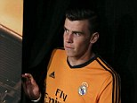 Curtain call: Gareth Bale emerges in Rea Madrid's new orange third kit