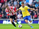 Star: Mesut Ozil is a new star for Arsenal