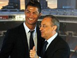 Thumbs up: Cristiano Ronaldo poses with club president Florentino Perez after a ceremony at Santiago Bernabeu to announce his new deal