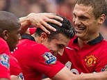 Flying Dutchman: Van Persie (second right) is mobbed after scoring against Crystal Palace on Saturday