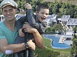 Trading places: Tom Brady bonds with his boys at a Boston park... while his sprawling property stands quietly idle in LA